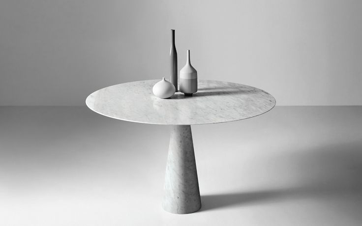 Leaf by Neutra is a custom made dining table carved from a unique block of solid stone, from Pure Interiors.