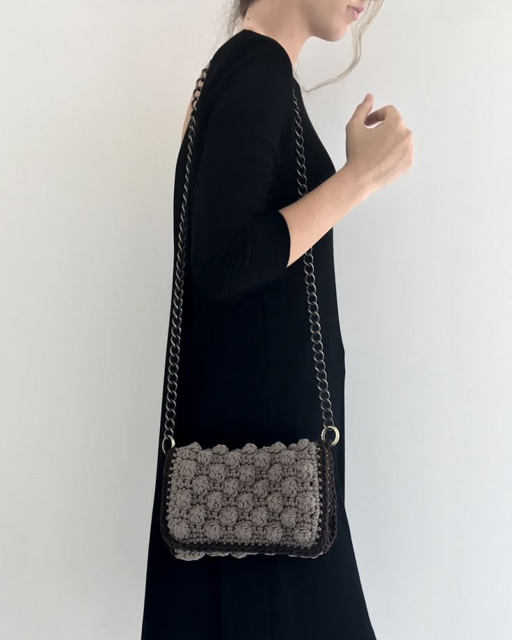 Handmade crochet flap bag . Interior removable pvc pochette. Closes with magnetic clasp. Size: 23x16 Comes in a dust bag  Markella Fili Creations