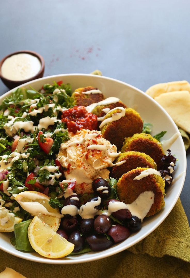 The ULTIMATE Mediterranean Bowl with hummus, falafel, tahini sauce, olives and pita! #vegan #glutenfree #falafel #recipe #healthy #minimalistbaker