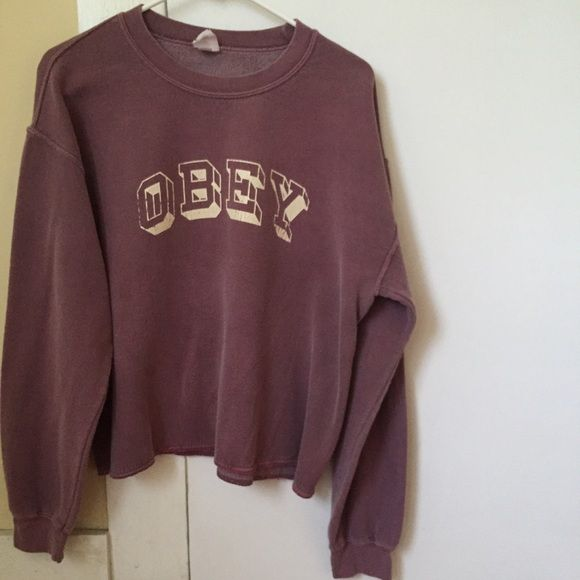 Purple Obey Sweatshirt Purple/pink OBEY sweatshirt. From Urban Outfitters! Women's Size Medium. Bottom has a cut look but not frayed. Good condition! There's a faint dryer stain on the front. Obey Tops Sweatshirts & Hoodies