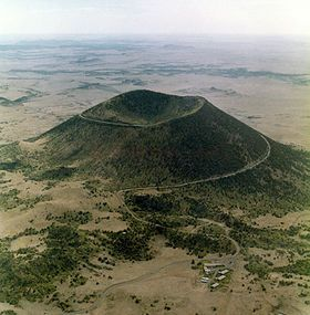 Capulin Volcano National Monument, located in northeastern New Mexico,The park is open daily except for Thanksgiving, Christmas, and New Year's Day. NPS staff are present from 8:00 a.m. to 4:30 p.m. Vehicles may travel to the volcano rim only during staffed hours.  Visitors may access the road to the rim until 4:20 p.m.  After hours, visitors are welcome to hike or bike the road to the top.