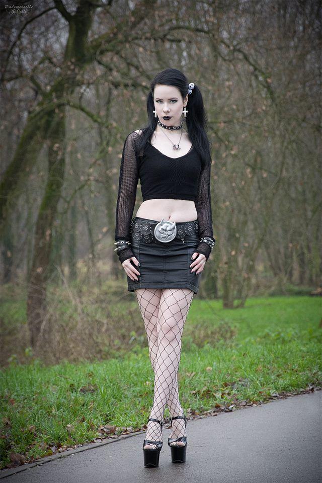 01428bb3661e Goth girl wearing very high platform sandals.
