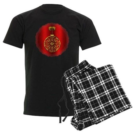 Gold Christmas Bauble on Red Pajamas
