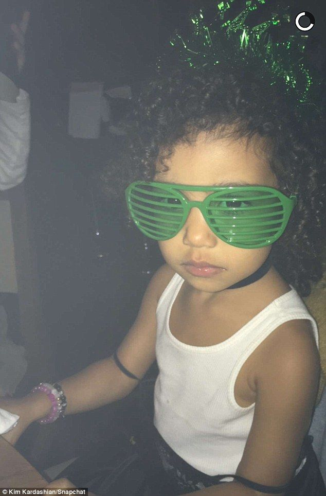 Too cute: North donned a pair of green shutter shades and a green tiara