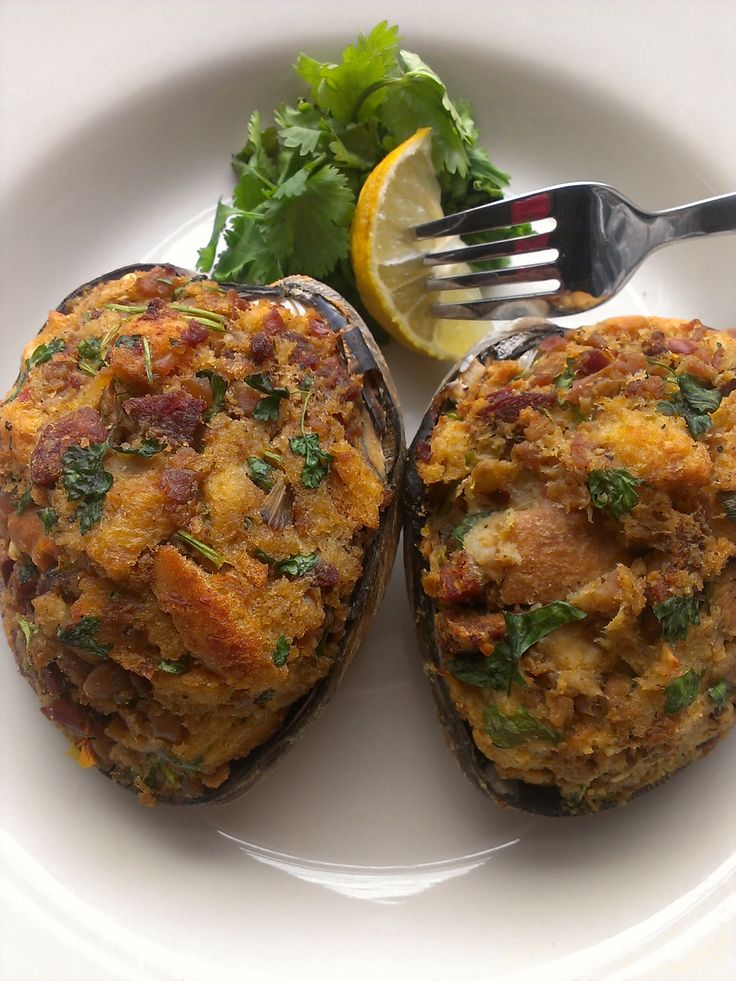 Stuffed Quahogs have been one of my favorites since I can remember. Fishing shorelines and digging the sandy bottom of Narraganset Bay with my feet feeling around for clams was a great part of my life growing up in Rhode Island - an inescapable part of my Portuguese / New England heritage.