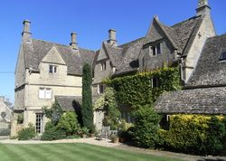 Clapton Manor | United kingdom Gloucestershire England. Lovely old manor house - Persian rugs on flagstoned floors, log fires, pretty bedrooms - and a beautiful garden full of birdsong and roses