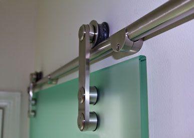 Detail of hanging mechanism for interior glass door
