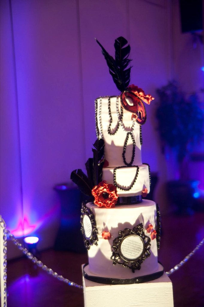 Mascarade Ball inspired wedding cake. Includes edible picture frames with love poems written by the bride and groom.  http://www.thecakemuseum.ca/