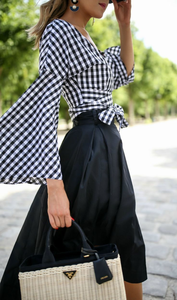 Click for outfit details! black and white gingham wrap top with v-neck and bell sleeves, black cotton poplin asymmetrical midi skirt with tie waist, black and white pearl and resin drop statement earrings, black straw boater hat, low block heeled sandals, straw woven basket bag {janessa leone, fame and partners, kendall & kylie, prada, classic style}