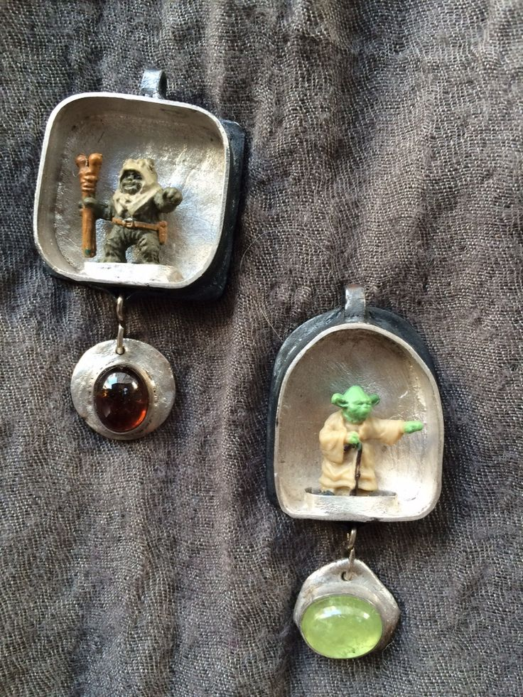 Two Star Wars shrine pendants, commission, 2016. Fine silver/silver clay, vintage plastic figures, two kinds of garnet.