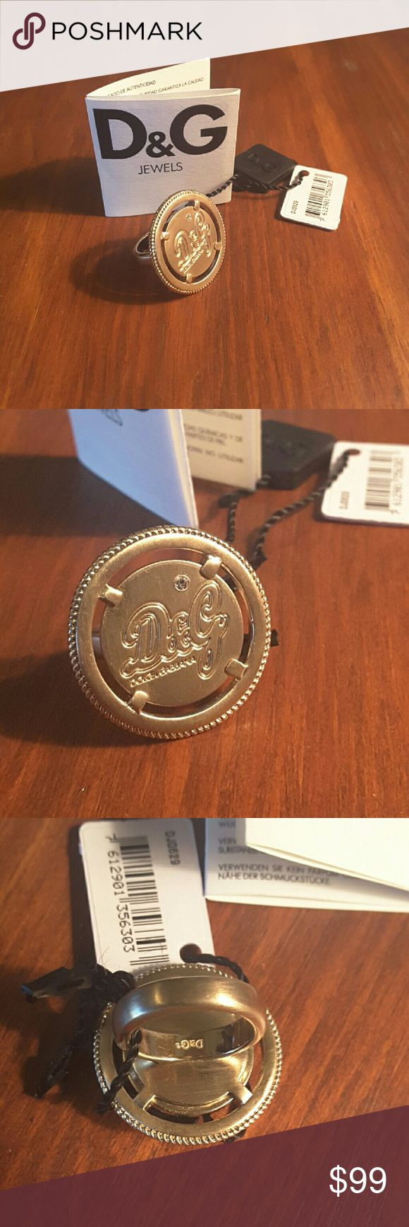 D&G Gioielli token anello Moneta ring size 7 D&G Gioielli gold token anello Moneta ip oro (token money ring in gold) ring size 7  Kind of dark gold color w D&G logo w single gem above  Certificate  & gift box included, NWT DJ0629  Make an offer today! D&G Jewelry Rings