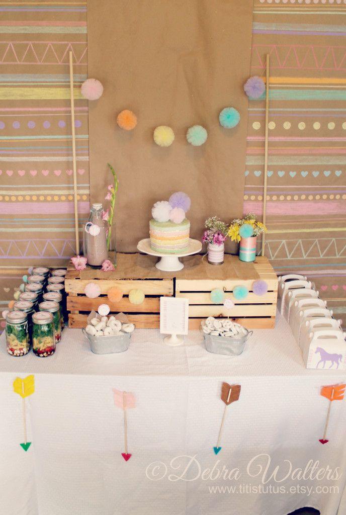Love the pom poms + aztec/tribal inspiration in this dessert table! #kidsparty #desserttable #party