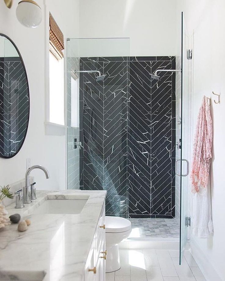 Gorgeous black chevron marble subway tiles in the shower. Swoon!