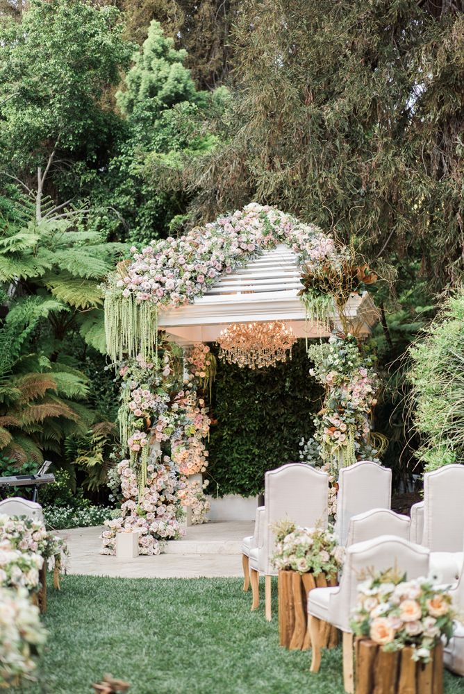 Breath taking huppah created by Celio's Design at Hotel Bel Air.   Rentals by Reverlry  Copyright by Gloria Mesa Photography