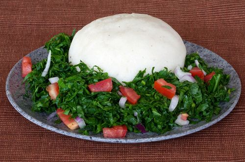 Ugali is prepared by boiling water and then adding maize flour. The mixture is stirred and turned to form a dense cornmeal paste. It goes down well with meat stew or Sukuma Wiki (kale or collard greens).