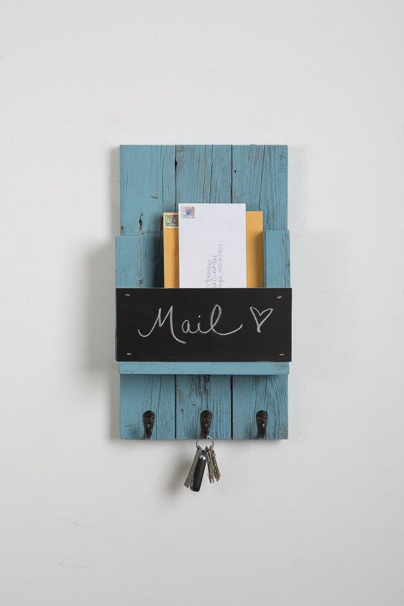 Cute mail slot with chalkboard and hooks.