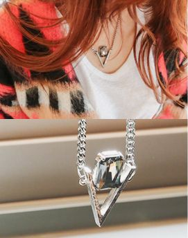 Cherryspoon CZ Pendant Chain NecklaceWith an upside down triangle frame accented with a CZ charm strung on a delicate chain link necklace, this piece is a modern,casual accessory. With its adjustable length due to the extender chain and clasp closure, this matinee necklace can be easily mixed and matched with a variety of looks.- Matinee necklace- With extender chain and clasp closure- Upside down triangle pendant- CZ accent- Antique finish- Color: Silver
