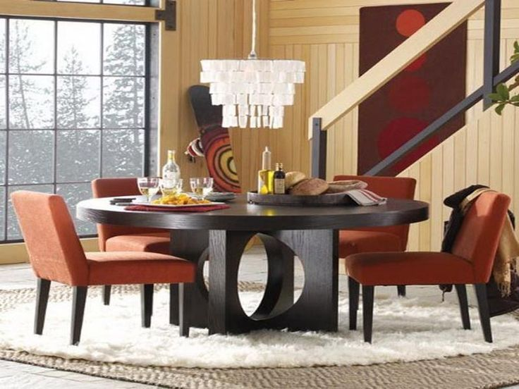 Black Wooden Roung Table Perforated Toe Design With 4 Orange Chairs And Rug  Fur ~ http
