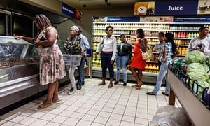 Middle-class no longer eating what they grow, contributing to rising numbers of overweight people and creating a 'double burden of malnutrition', say researchers. Shoppers queue at a Pick n Pay supermarket in Cape Town, the South African capital
