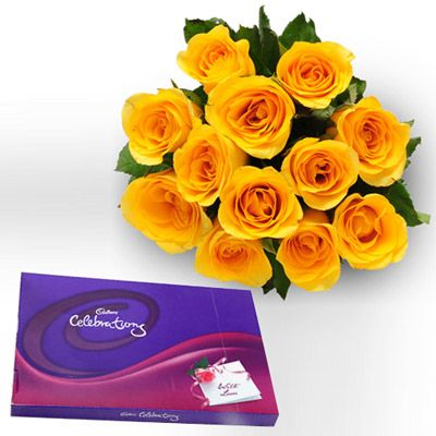 Bunch of 12 Yellow Roses in cellophane Packing with yellow ribbon bow and box of 139gms big #Cadbury #celebration #chocolate. http://www.fnp.com/flowers/style-celebration/--clI_2-cI_1123-pI_23684-i_23230.html