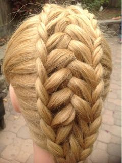 Triple dutch braid: feathered center braid and then dutch braid the sides using the feathers