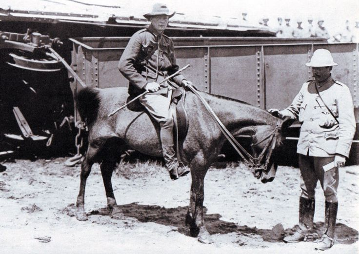 Winston Churchill (on the pony) by the wrecked railway trucks of the Armoured Train at Chievely on 15th November 1899 during the Boer War