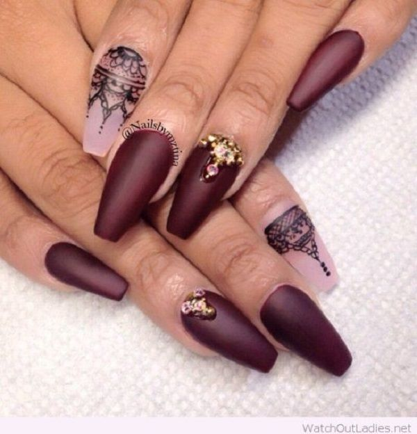 Lace inspired pink and maroon nail art design. As you can see the pink nails have lace inspired designs on top with black polish while the rest of the nails are in matte maroon with gold and red embellishments on top for accent.