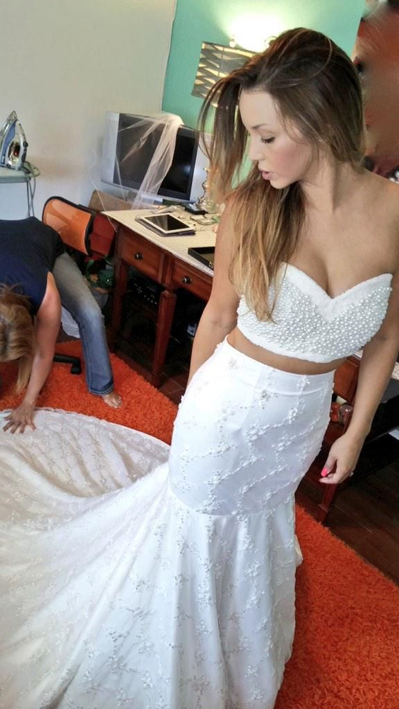 """""""Her dress, without a doubt, was uniquely Scheana,"""" her wedding planner Danielle Rothweiler told The Knot of her custom look. """"She had no desire to be in a traditional wedding gown, and instead opted for a crop top gown. The gown was actually made by her aunt and it included removable straps. She kept the straps down for the ceremony and then pulled them up for the reception so that she could have fun without pulling her top up all night."""""""