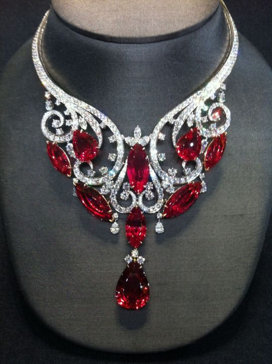 """Harry Winston 180ct Spinel THE GEMSTONE SPINEL Spinel is most famous for its deep red variety that closely resembles Ruby. These two gemstones can be very difficult to distinguish. Until the late 19th century, there was no distinction made between Ruby and red Spinel, as they look identical and are found in the same localities. Many famous old """"Rubies"""" were discovered to be in fact Spinel."""