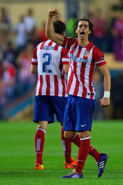 Tiago of Club Atletico de Madrid celebrates victory during the UEFA Champions League Quarter Final second leg match between Club Atletico de Madrid and FC Barcelona at Vicente Calderon Stadium on April 9, 2014 in Madrid, Spain.