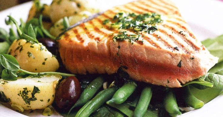 Tuna steaks are perfect for a quick summer meal. Simply combine them with baby potatoes and greens and pour over the zesty herb dressing.