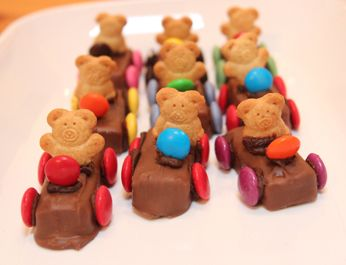 Teddy Graham Racers or Teddy Graham Cars. Simple and sweet, Teddy Graham Racers make the perfect treat! Add some colour to any party table with these adorable goodies! Kids will have a lot of fun making these. Its the perfect activity for parties or a lazy afternoon.