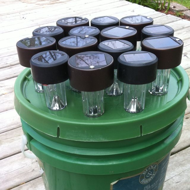 Holder for rechargeable lights.  Just made this to hold our lights that we take camping with us.  Inside the bucket we can put our electric lights.  Now all of lights can be in one place and ready to go.