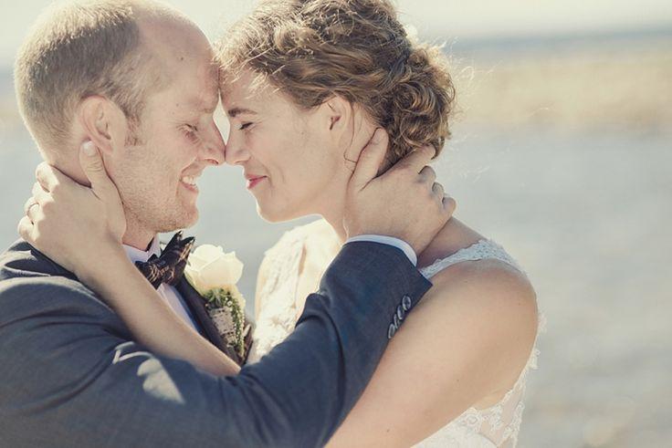 Bride and groom Wedding portrait by the ocean in Sweden Lövånger