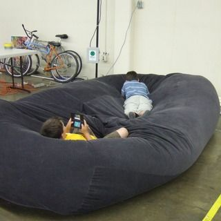 How to make a giant bean bag...looks so comfortable! I'm thinking of using dollar store plastic table clothes so I can use it outdoors.