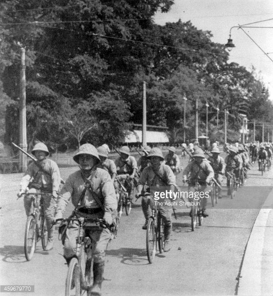 Imperial Japanese Army bicycle unit soldiers run in the ...