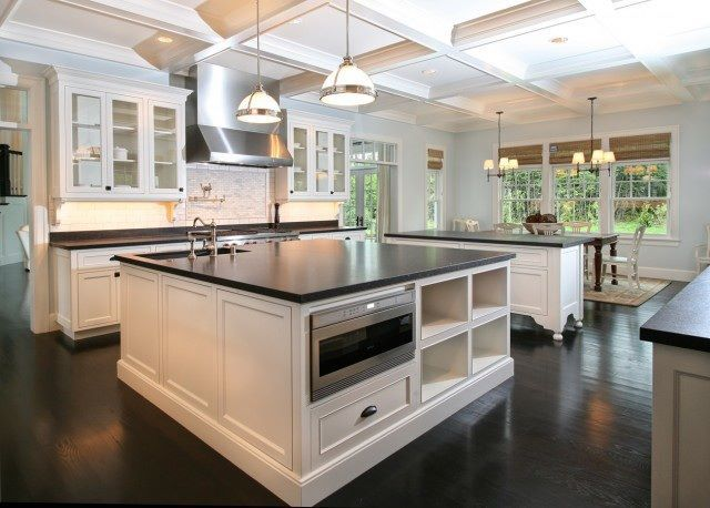 * blacks and whites help maintain the timeless appeal of a classic kitchen, often seen on countertops using materials like honed absolute black granite, soapstone, or quartz...