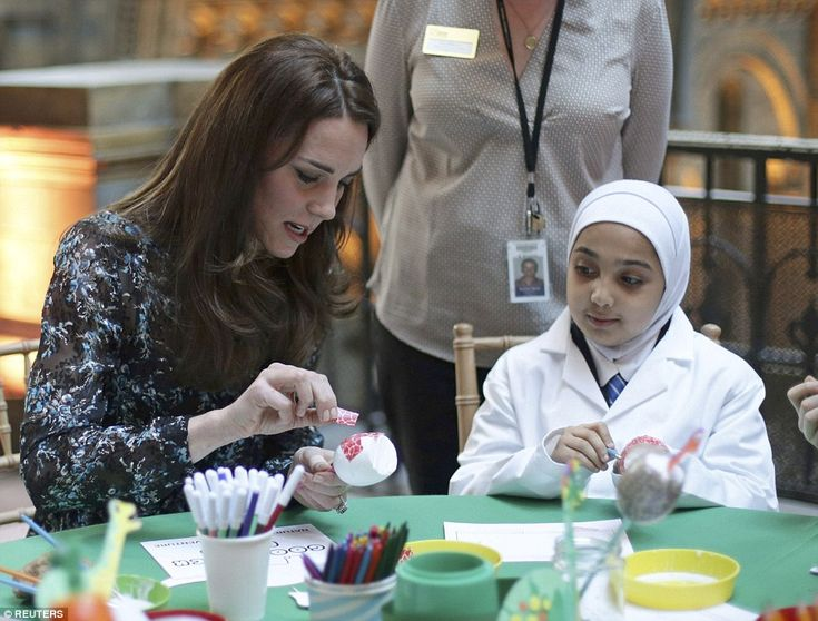 I like your thinking! A young school girl watches as Kate adds decorations to her dinosaur...