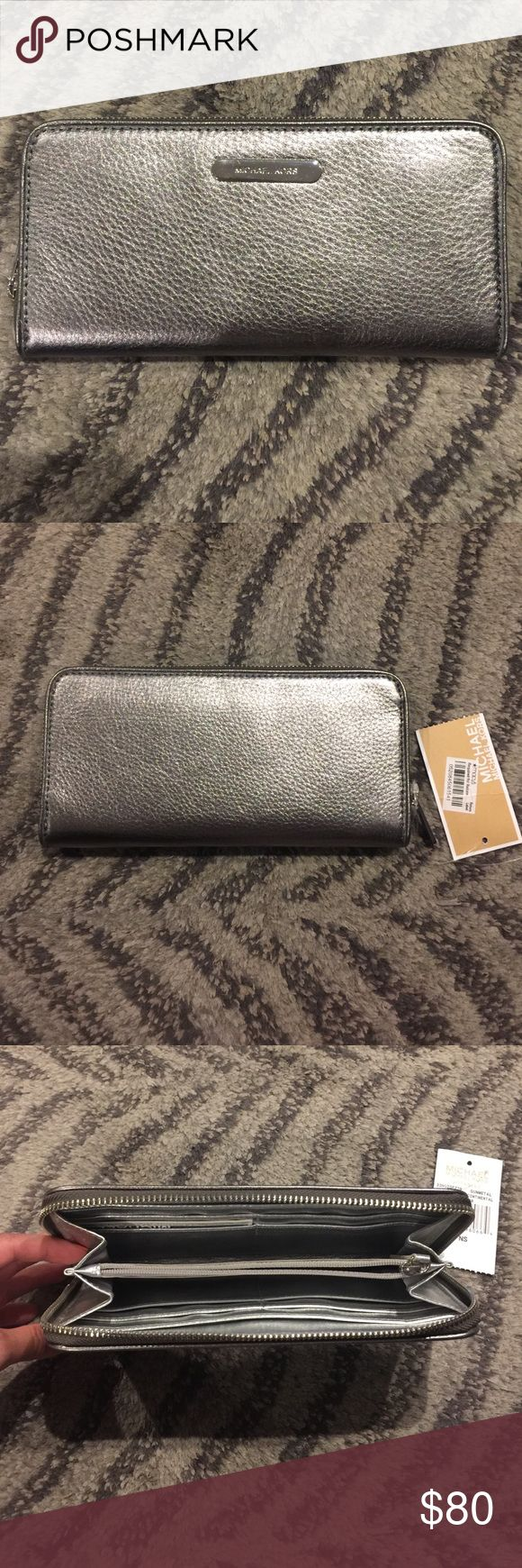 Gunmetal Leather Michael Kors Continental Wallet This genuine leather Michael Kors zip around continental wallet is gunmetal with a silver inner lining, 6 credit card slots, compartments for cash and coins, and plenty of room for anything else you need to carry with you! It is brand new, with tags, and is perfect to give as a gift, or to keep for yourself. Don't miss out!!! MICHAEL Michael Kors Bags Wallets