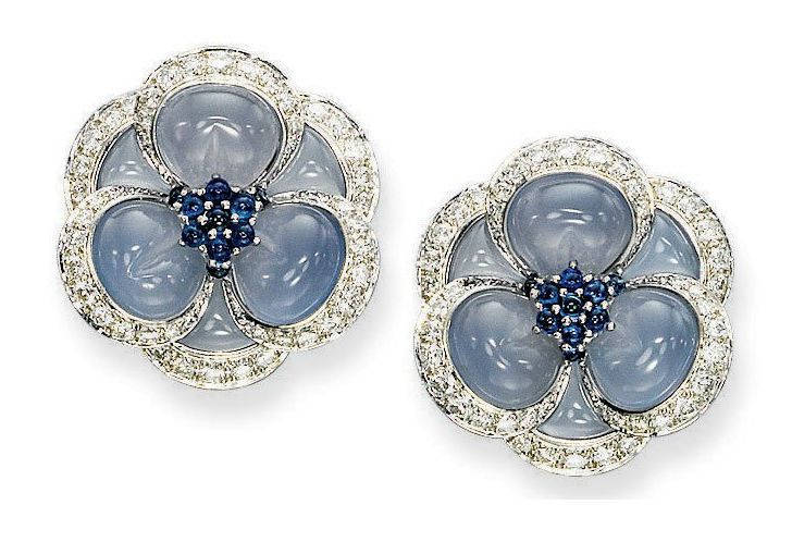 """A PAIR OF BLUE CHALCEDONY, SAPPHIRE AND DIAMOND """"BLUE GARDENIA"""" EAR CLIPS, BY VAN CLEEF & ARPELS Each flowerhead set with carved cabochon blue chalcedony and circular-cut diamond petals to the cabochon sapphire pistils, mounted in platinum and 18k white gold, one small diamond deficient, 2.7 cm wide Signed Van Cleef & Arpels, no. N.Y. 63431"""