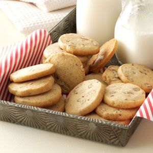 Aunt Iones Icebox Cookies      6 cups all-purpose flour     1-1/2 teaspoons baking powder     1 teaspoon baking soda     1 teaspoon ground nutmeg     1 teaspoon ground cinnamon     2 cups butter, softened     1 cup sugar     1 cup packed brown sugar     3 eggs     1 teaspoon vanilla extract     1 t lemon extract     2 c chopped nuts
