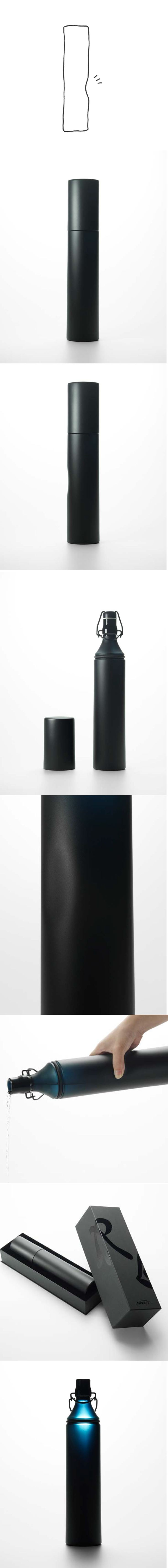 N Bottle by Nendo for  Nakata Hidetoshi Matte black sake bottle cylinder with slight dimple on side for hand rest.