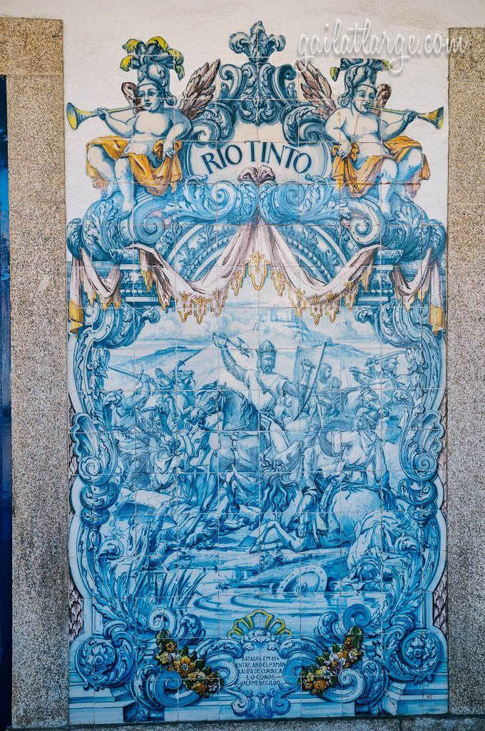 Rio Tinto Train Station opened on May 21, 1875, but the azulejos are from 1936, created by João Alves de Sá and made in Fábrica da Viúva Lamego. The scenes in the tile work are about the legend behind the place name Rio Tinto, which pre-dates Portugal's formation as a country. As the story goes, there was a battle between the Christians and the Moors in the early part of the ninth century that resulted in much bloodshed, causing the river to run red — hence the name.