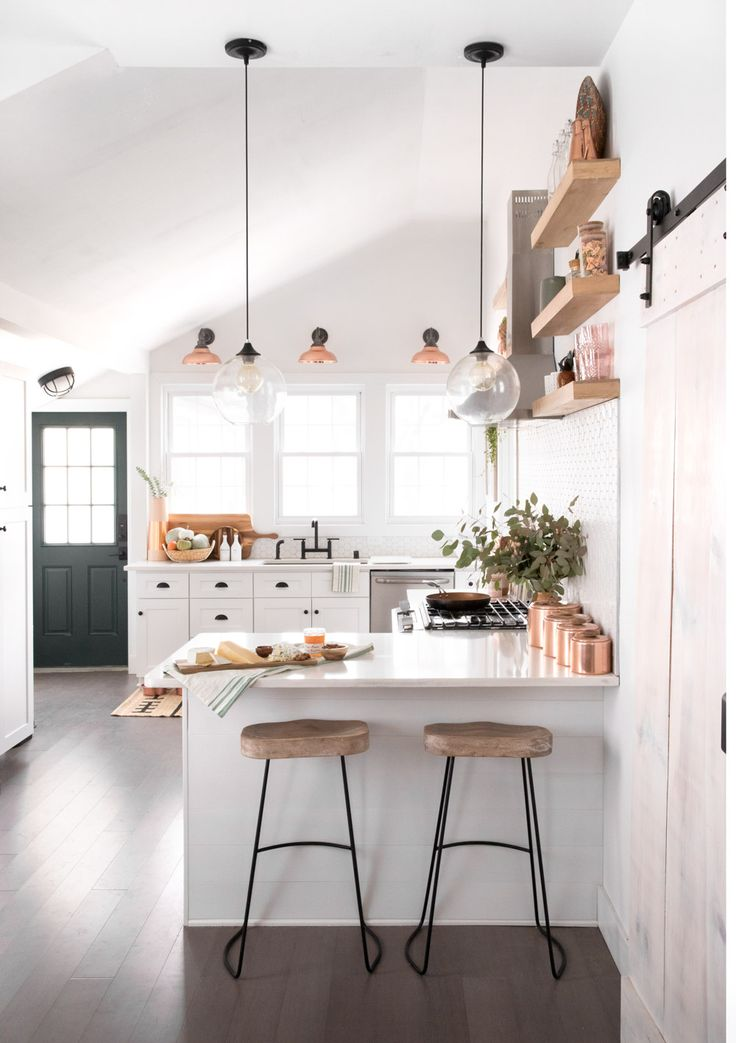 Gravity Home: Bright white kitchen with bar