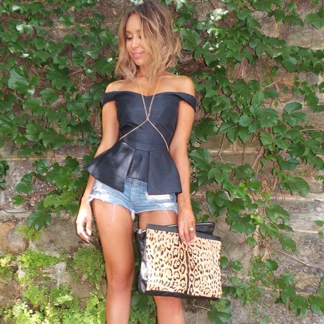 I love the black top which would go well with a white pencil skirt and with that bag but Minus the body chain!!! Amen...