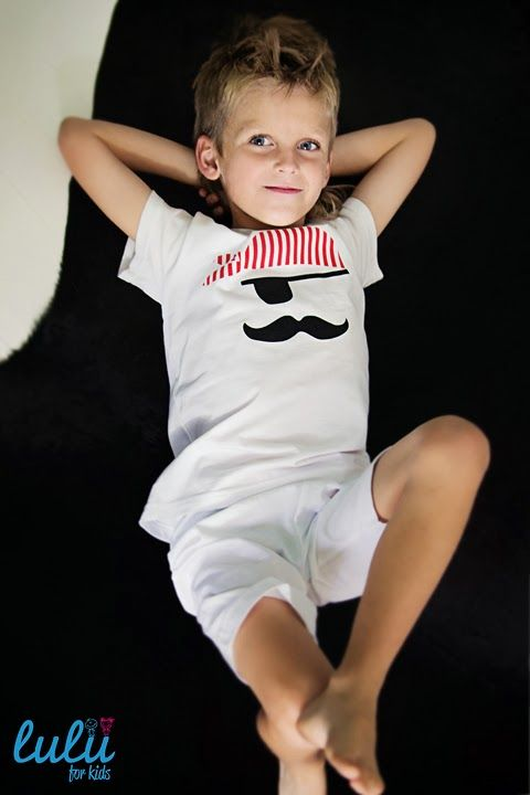 Lil' piarte in his PJ resting and dreaming about adventures ;) Short, white pants and t-shirt with a pirate print.