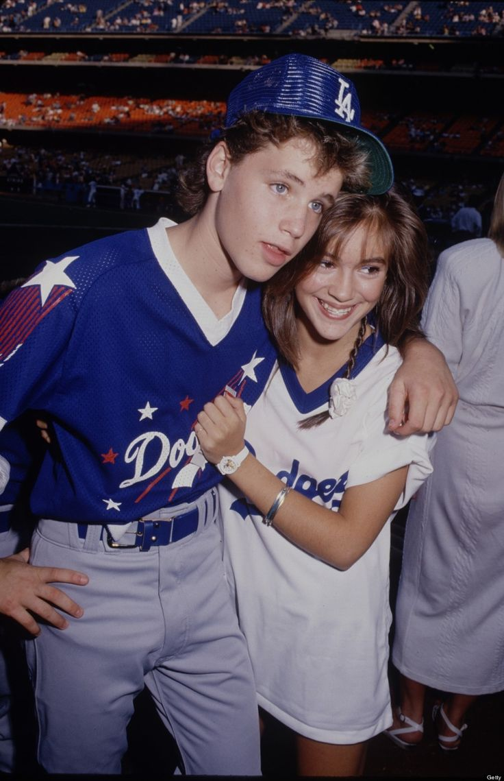 Alyssa Milano with a retainer and Corey Haim in 1987.
