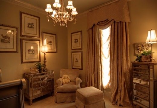 Elegant baby nursery: neutral color palate, silk drapes, mirrored furniture, crystal chandelier