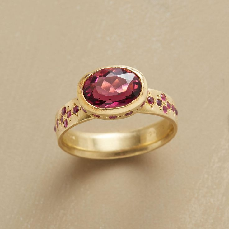 FOREVER IN PINK RING--Starburst rubies twinkle in the company of a dazzling pink tourmaline. Adel Chefridi intensifies the gemstones with a matte finish on recycled 18kt gold. Handmade in USA. Whole sizes 5 to 8.For Christmas delivery order must be placed by December 2nd, midnight MST    (expedited charges may apply.)