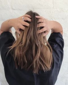 Tousling her tousled lob! Hair by Jordan at #PrettySalon